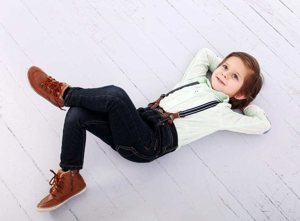 Download Free Stock Photo of Adorable kid well dressed, legs crossed
