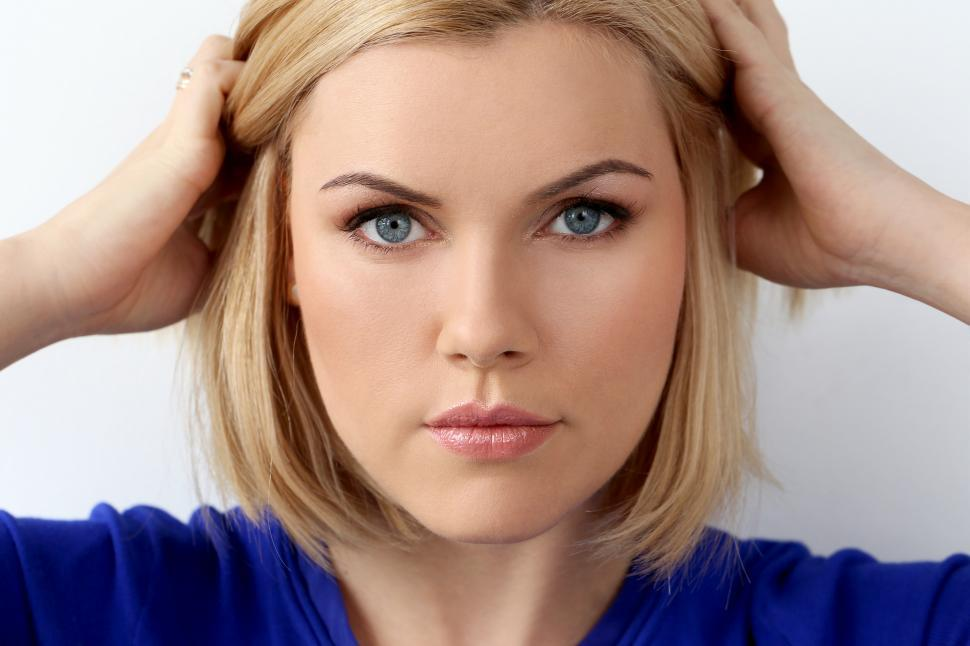 Download Free Stock Photo of Attractive woman with blue eyes looking at camera