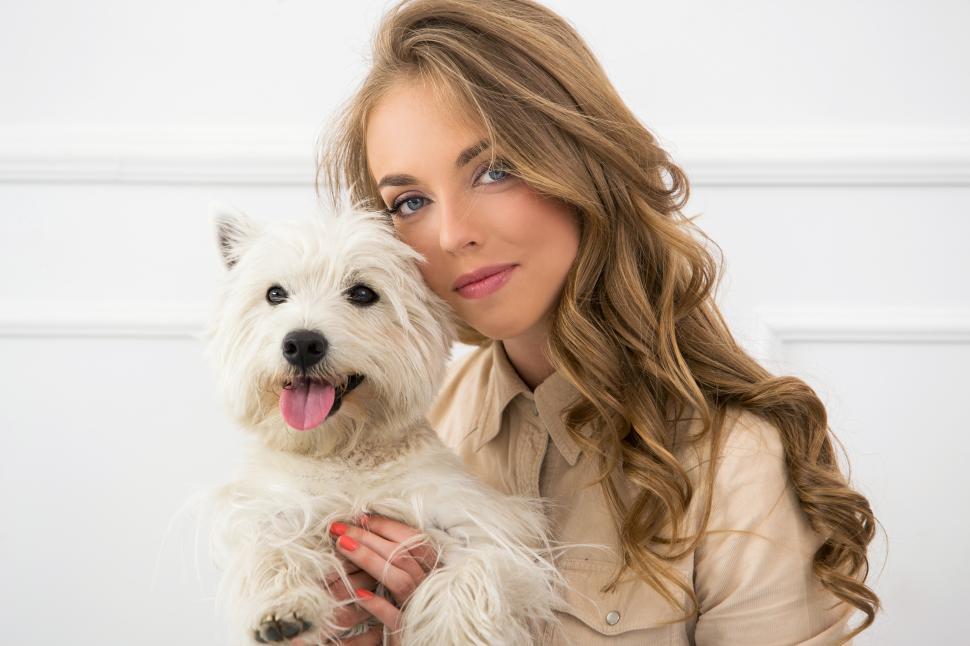 Download Free Stock Photo of Beautiful girl hugging her dog