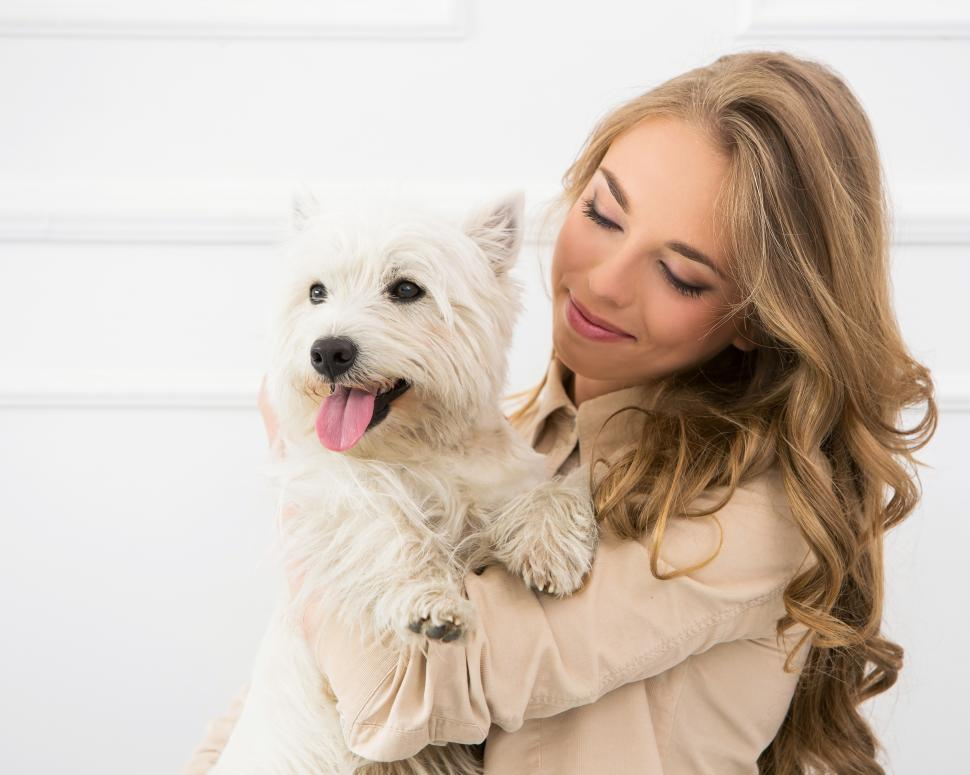 Download Free Stock Photo of Beautiful girl with her happy lap dog