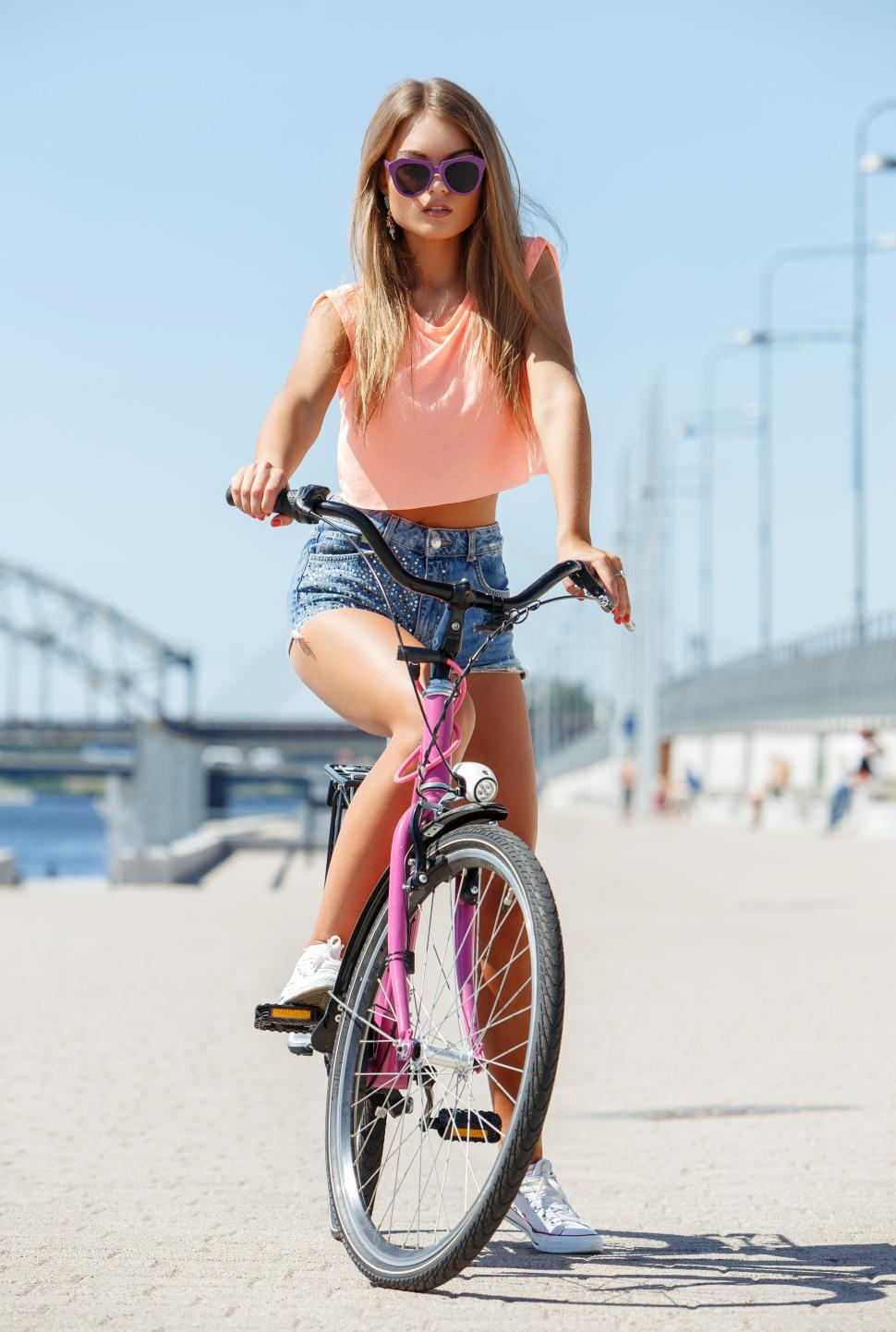 Download Free Stock Photo of Beautiful girl on a bike near the shore