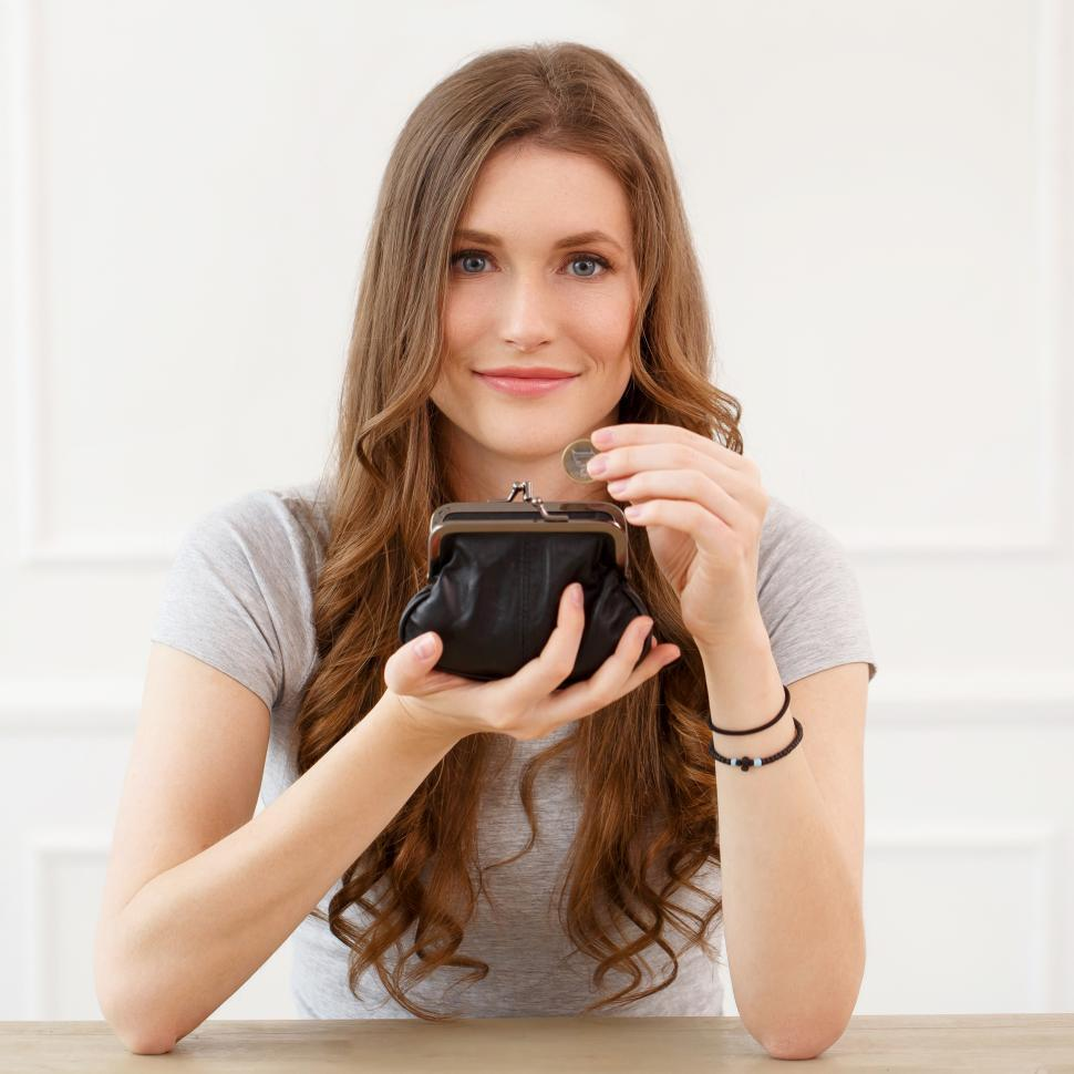 Download Free Stock Photo of Attractive woman with open wallet, saving money