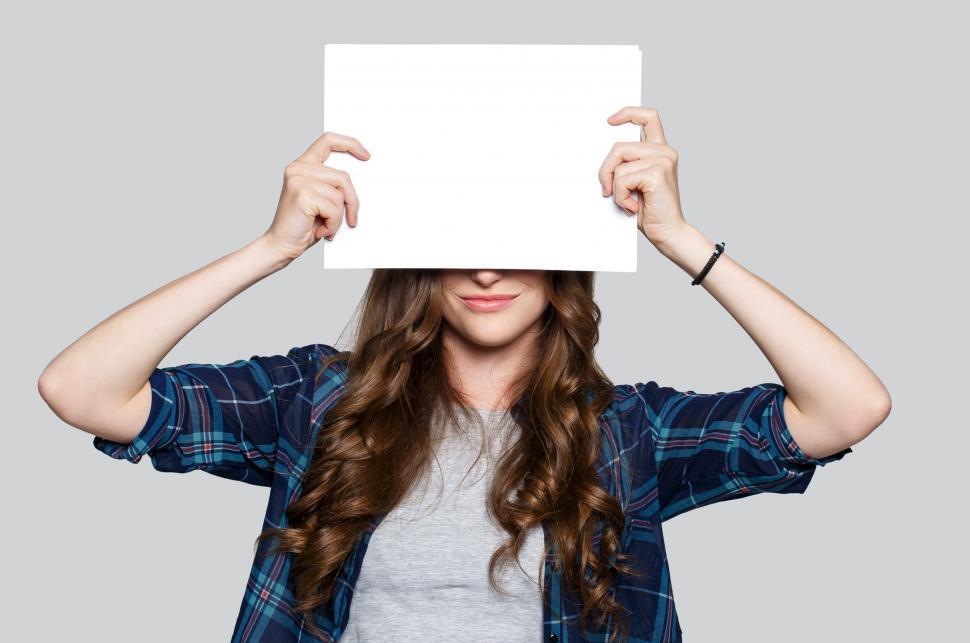 Download Free Stock Photo of Woman obscured by blank white billboard