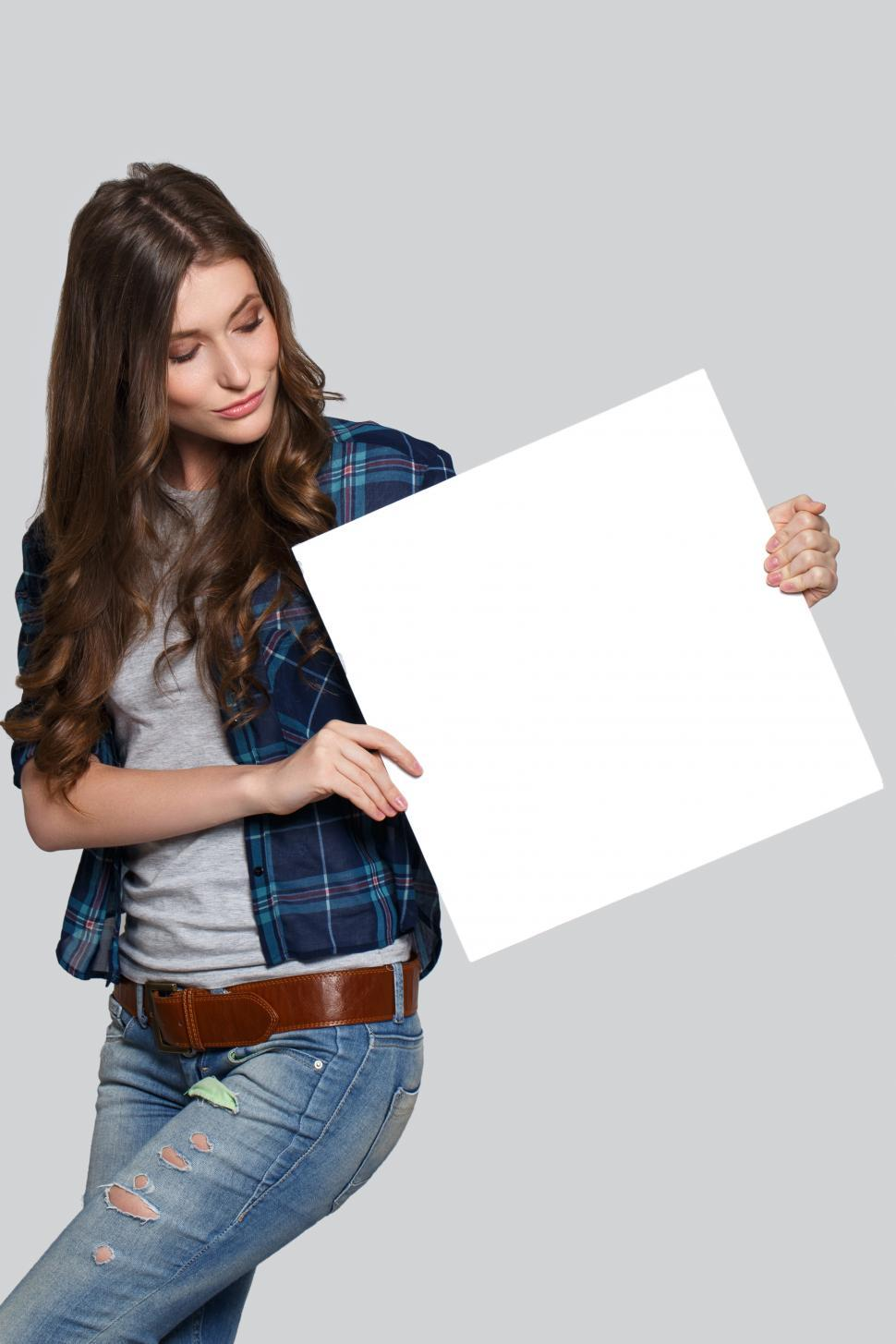 Download Free Stock Photo of Jaunty angle blank sign held by woman