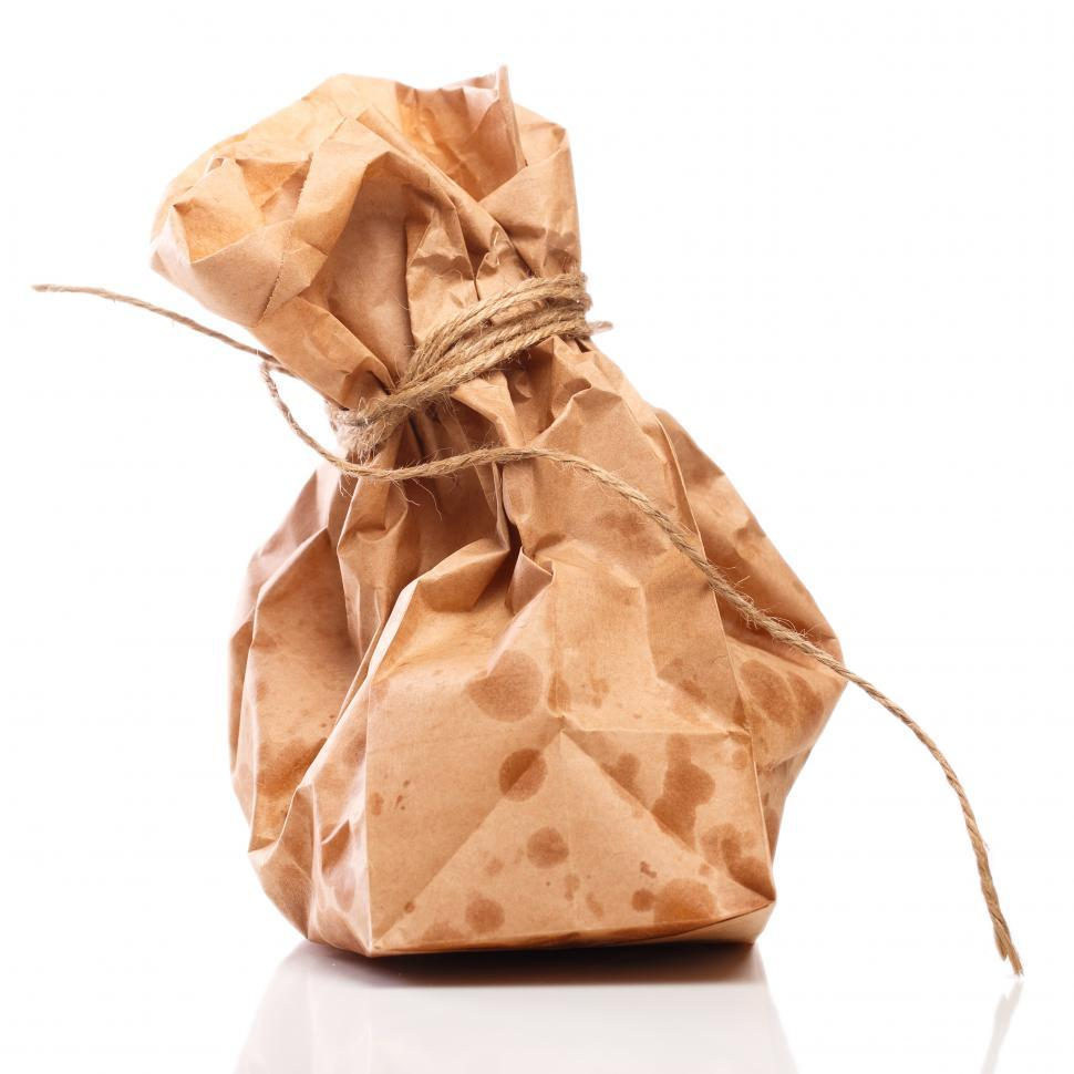 Download Free Stock Photo of Paper bag on the table full of greasy food