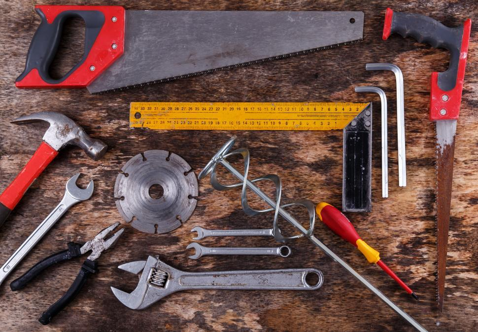 Download Free Stock Photo of Lots of hand tools arranged on a workbench