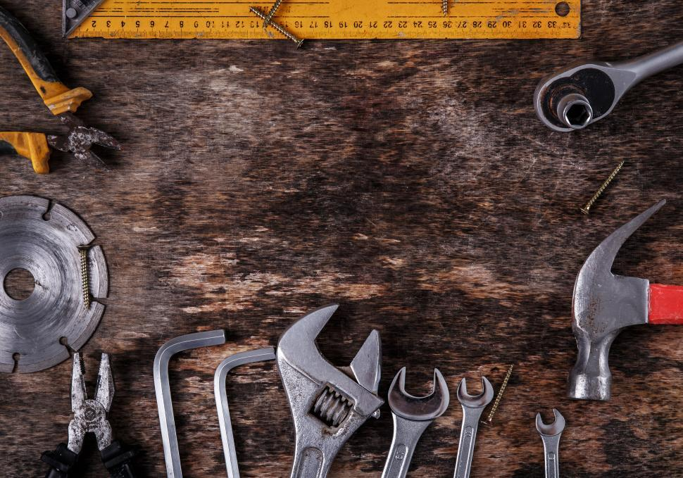 Download Free Stock Photo of Tools framing a spot on the bench. Copyspace.