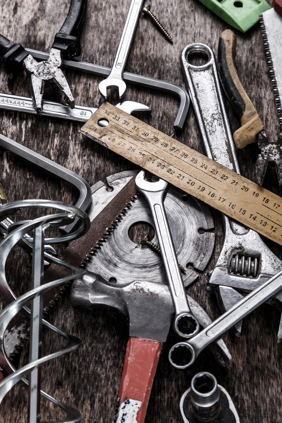 Download Free Stock Photo of Tools scattered on the table