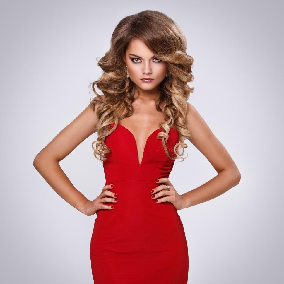 Download Free Stock Photo of Striking woman in a red dress