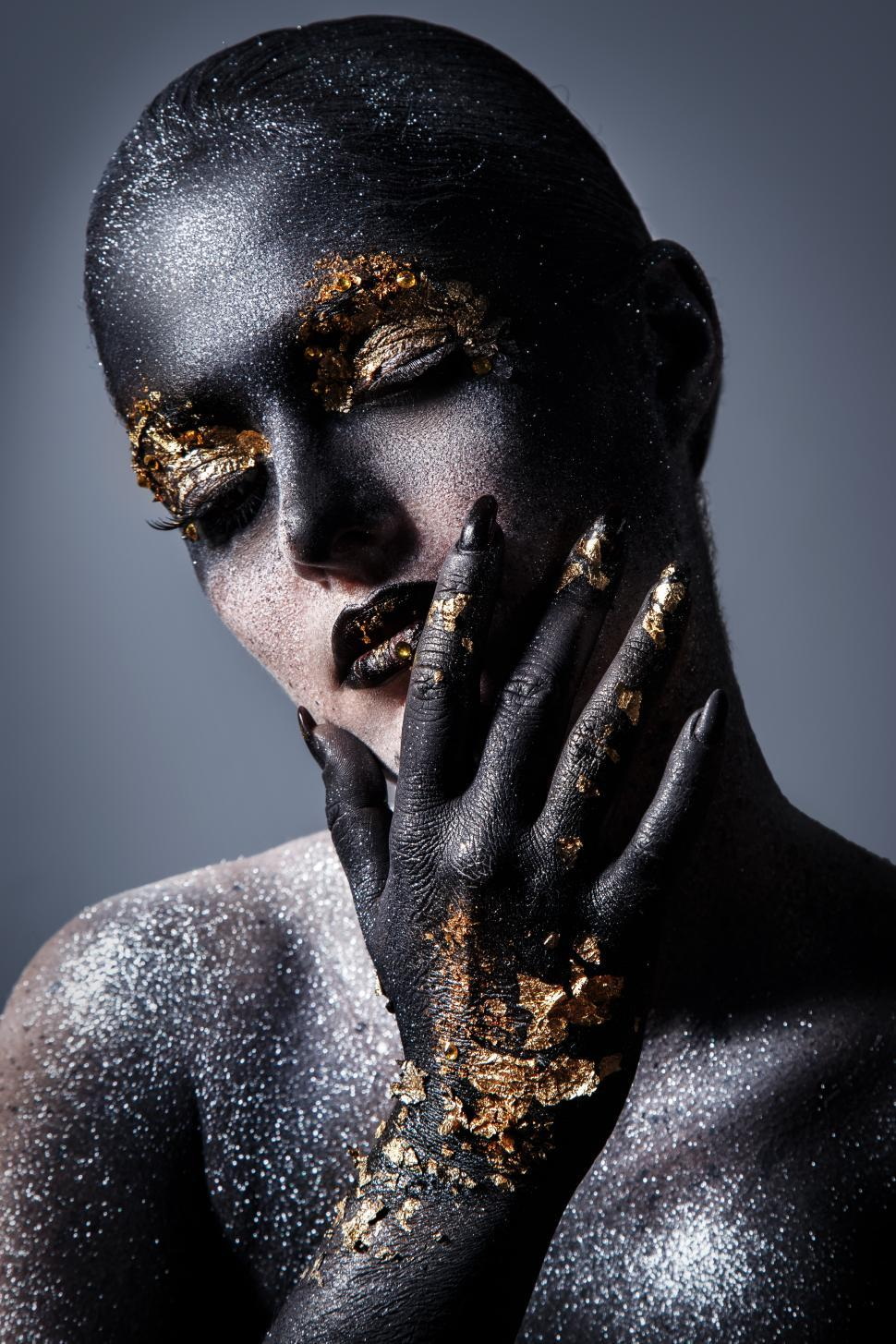 Download Free Stock Photo of Dramatic artistic makeup with gold accents