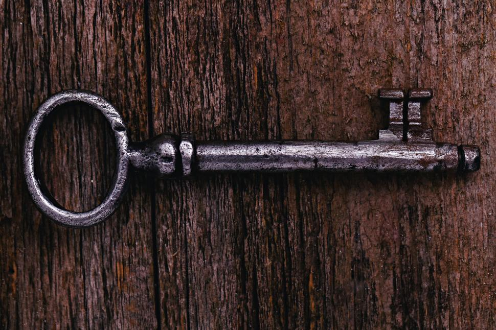 Download Free Stock Photo of Rustic key on weathered wood