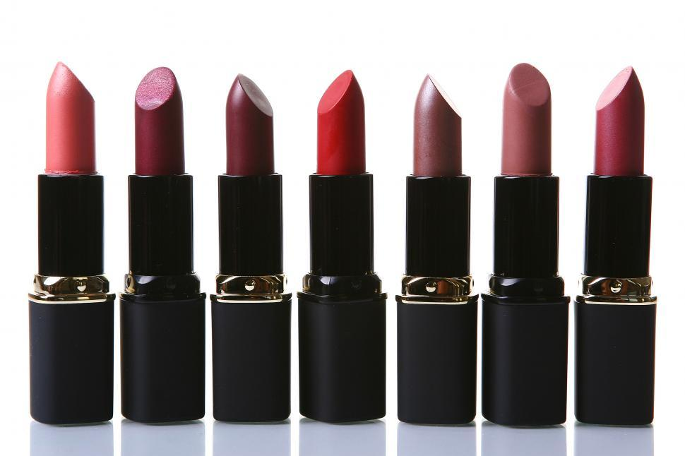 Download Free Stock Photo of Various shades of lipstick in a line