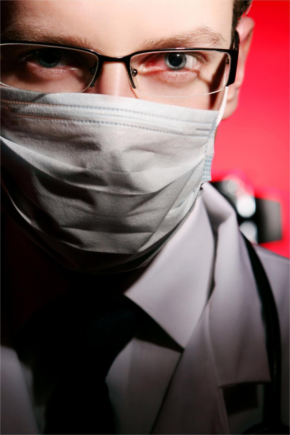 Download Free Stock Photo of Close up of young medical worker in a mask