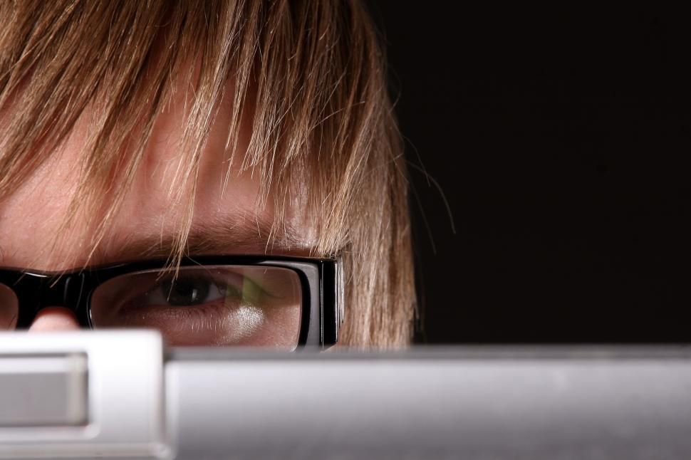 Download Free Stock Photo of Man in glasses peeking over screen