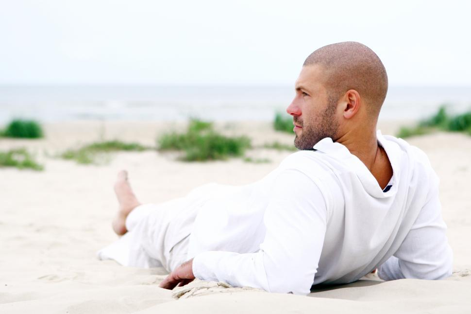 Download Free Stock Photo of Man resting and relaxing at the beach