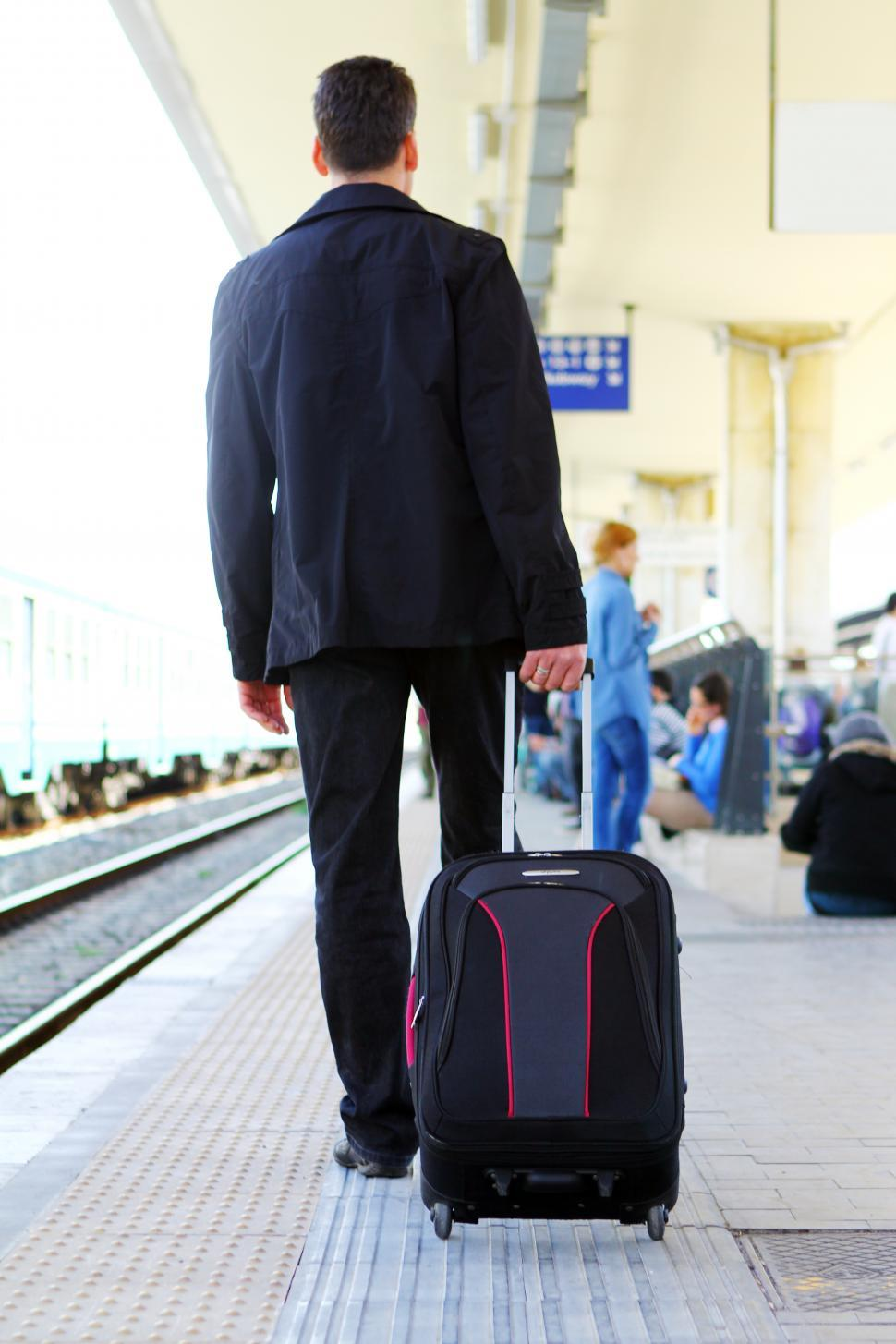 Download Free Stock Photo of Man with his baggage