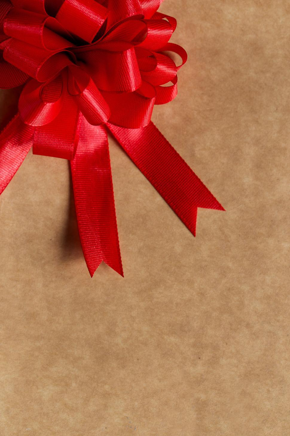 Download Free Stock Photo of Gift, celebration. Red, gorgeous bow on the table
