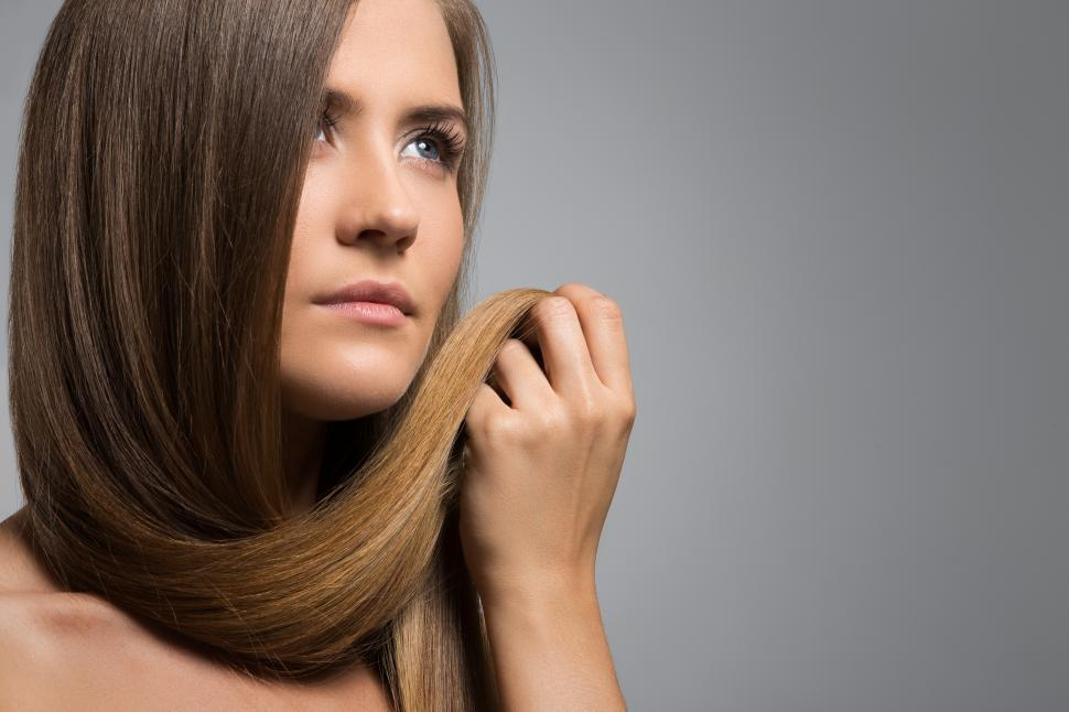 Download Free Stock Photo of Woman with her own hair clasped in her hand