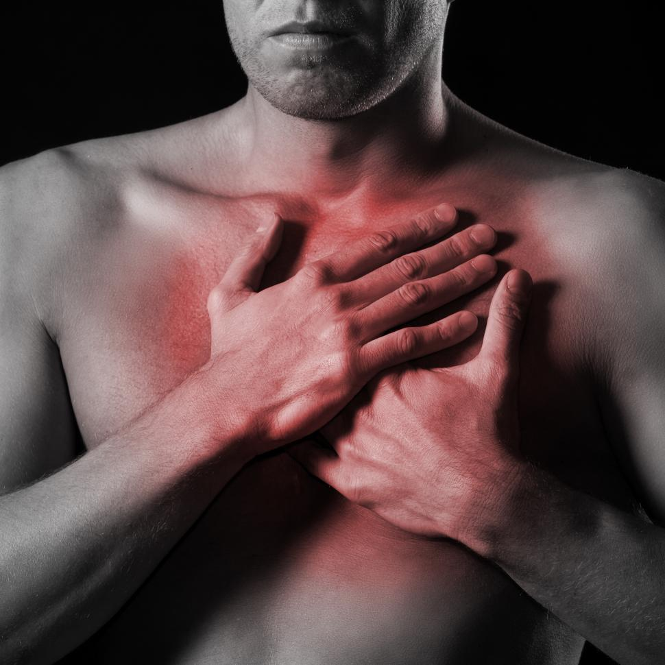 Download Free Stock Photo of Man and burning chest pain