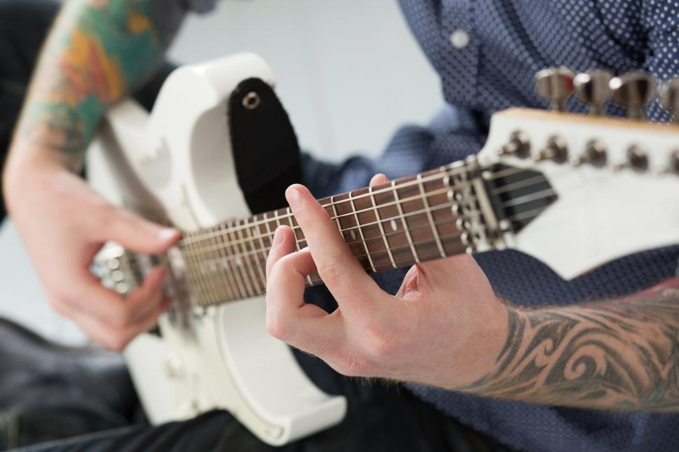 Download Free Stock Photo of Unknown man playing electric guitar
