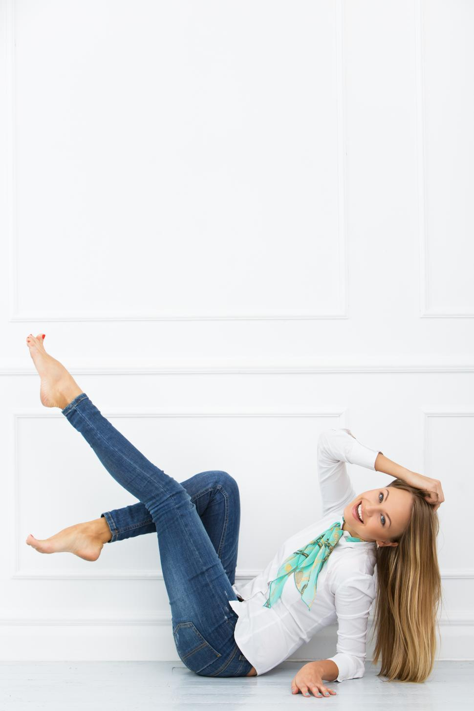 Download Free Stock Photo of Young woman kicking up her legs