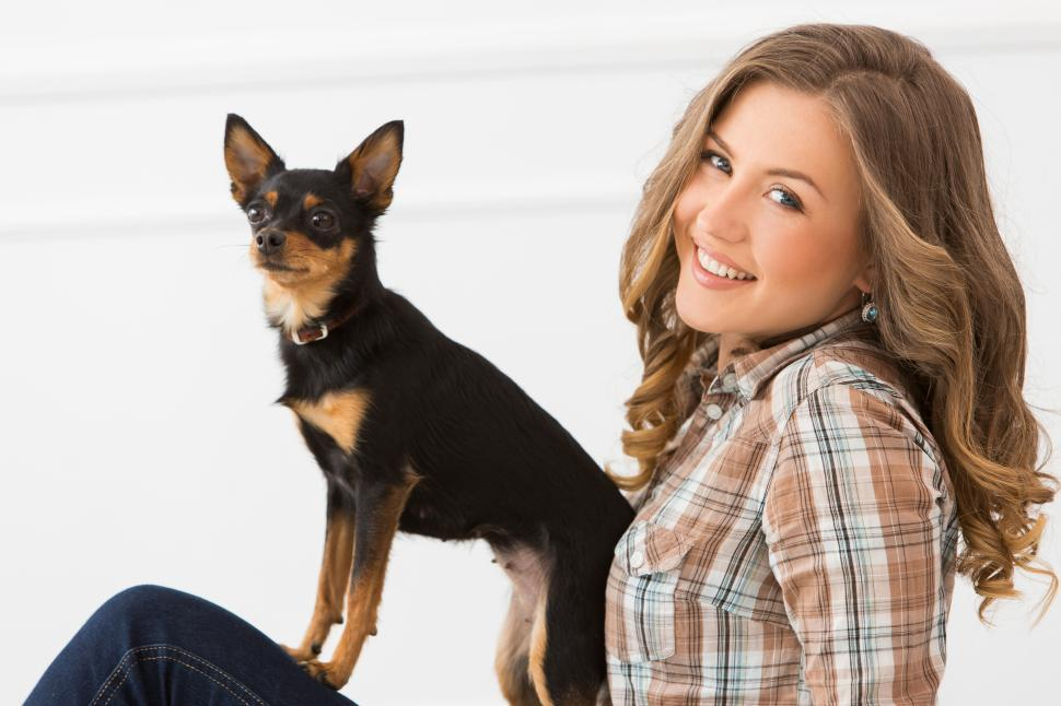 Download Free Stock Photo of Beautiful girl with a small dog
