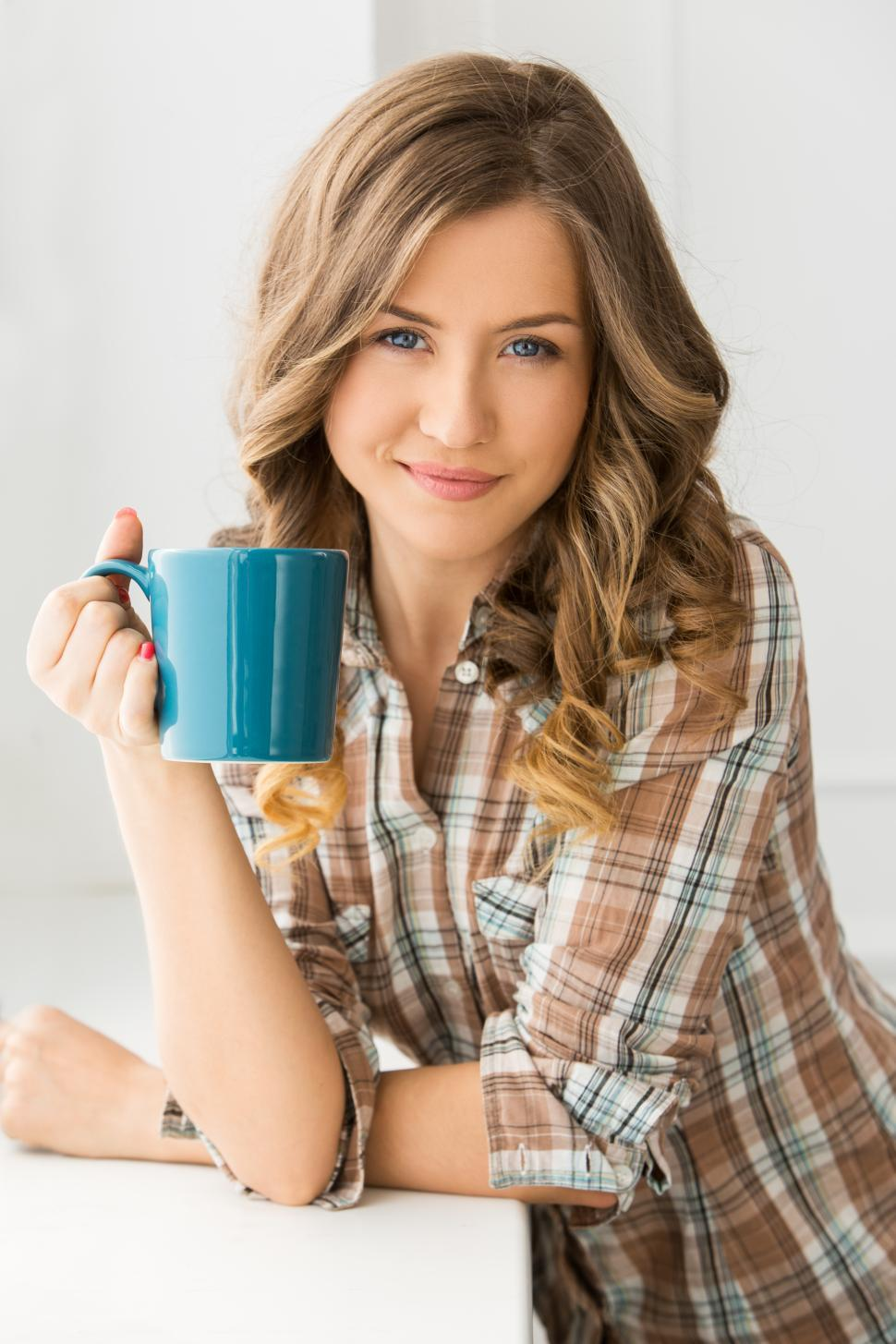 Download Free Stock Photo of Woman with a mug of hot beverage