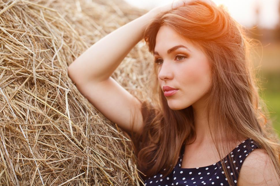 Download Free Stock Photo of Young woman in a hay field