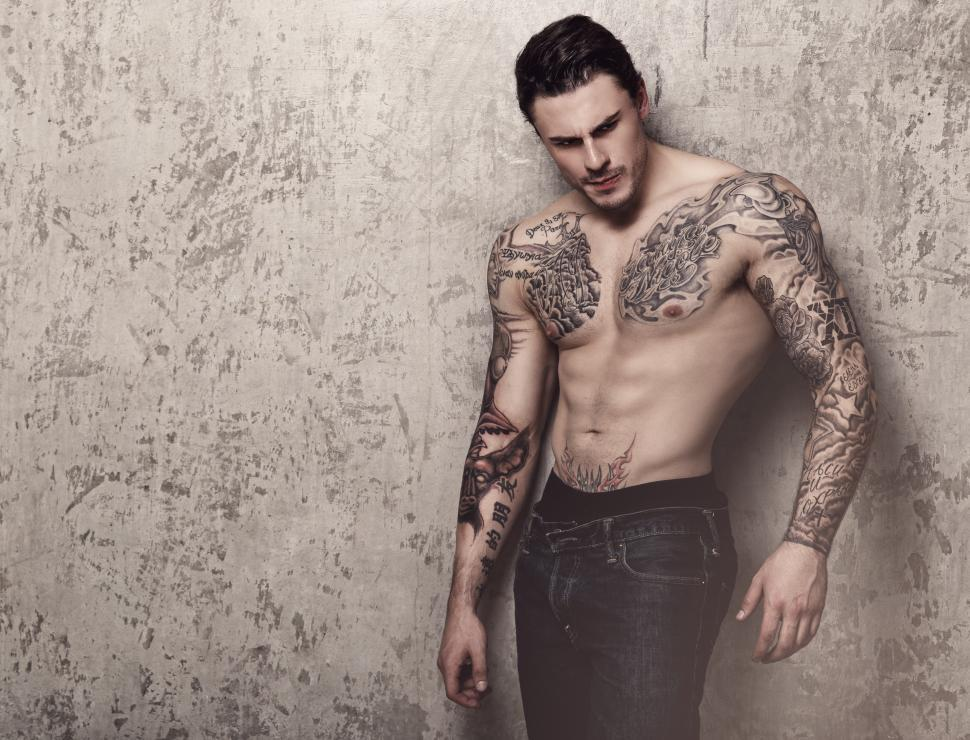 Download Free Stock Photo of Man with elaborate tattoos