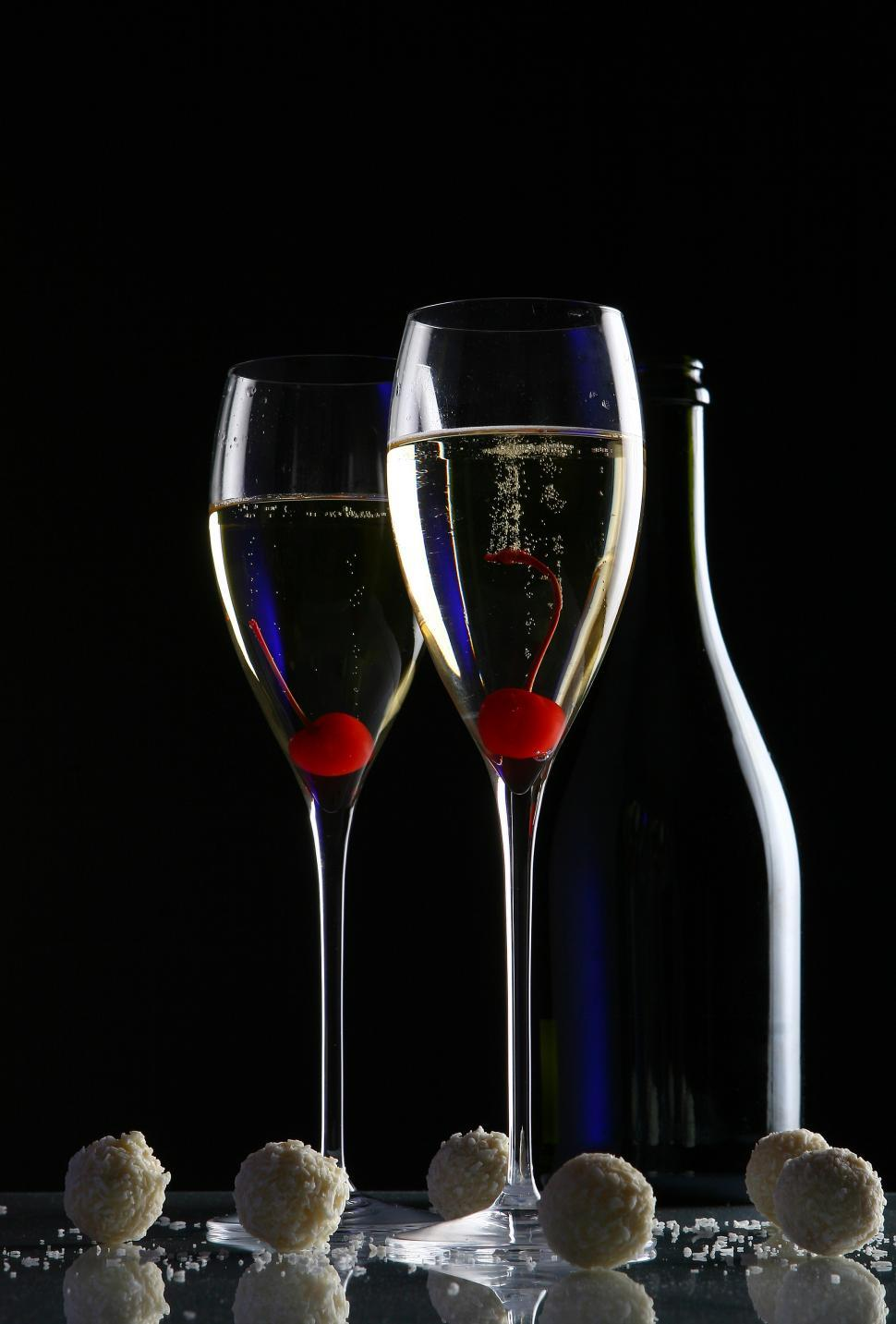 Download Free Stock Photo of two glasses of champagne, dark background