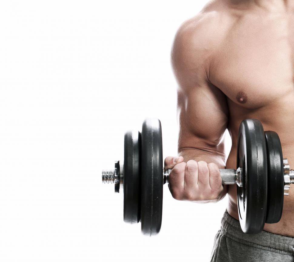 Download Free Stock Photo of Fitness. Man with dumbbell doing a biceps curl