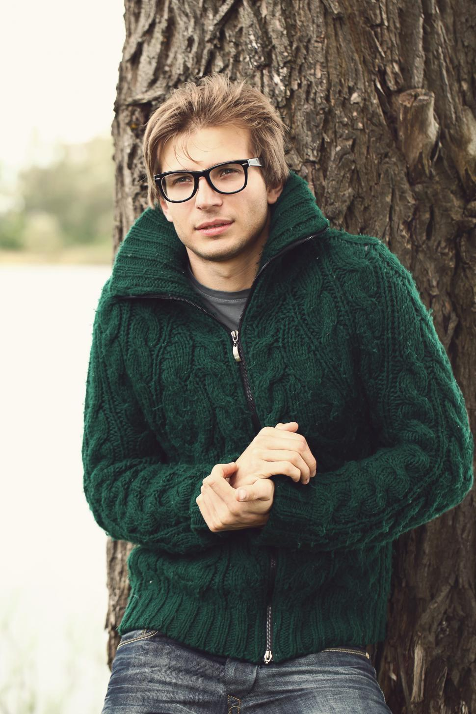 Download Free Stock Photo of Man in sweater outdoors against tree