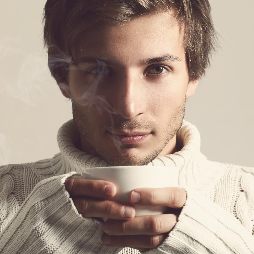 Download Free Stock Photo of Handsome man in sweater with hot beverage