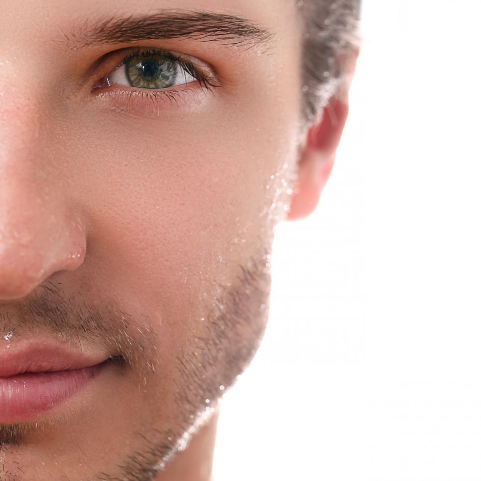 Download Free Stock Photo of Half face of handsome guy on a white background