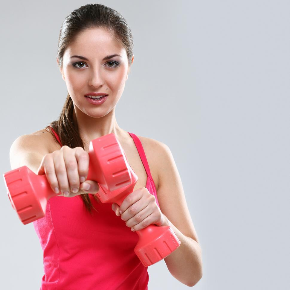 Download Free Stock Photo of Woman during workout with small weights