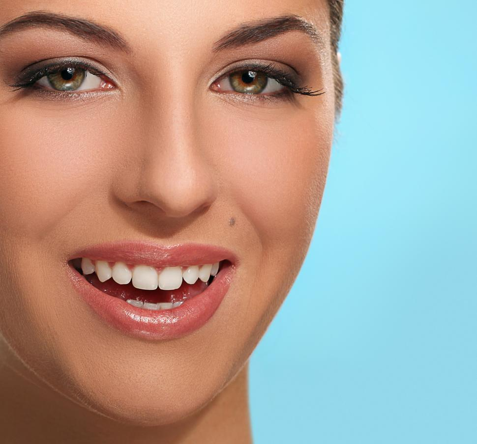 Download Free Stock Photo of Portrait of young smiling woman