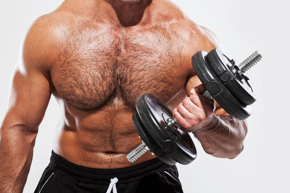 Download Free Stock Photo of Fitness. Man with one dumbbell