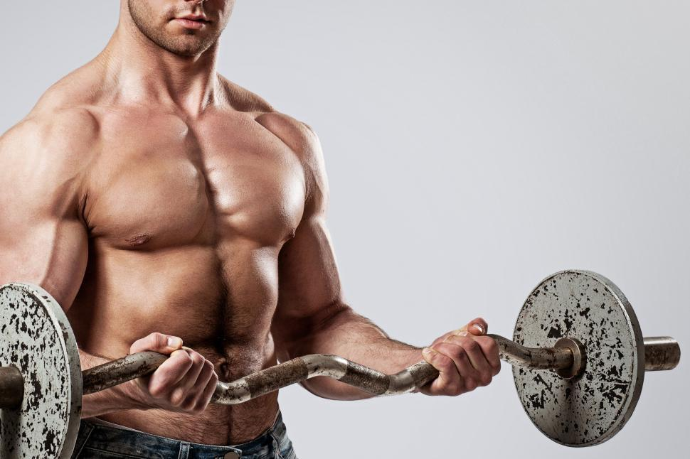Download Free Stock Photo of Fitness. Man with barbell doing curls