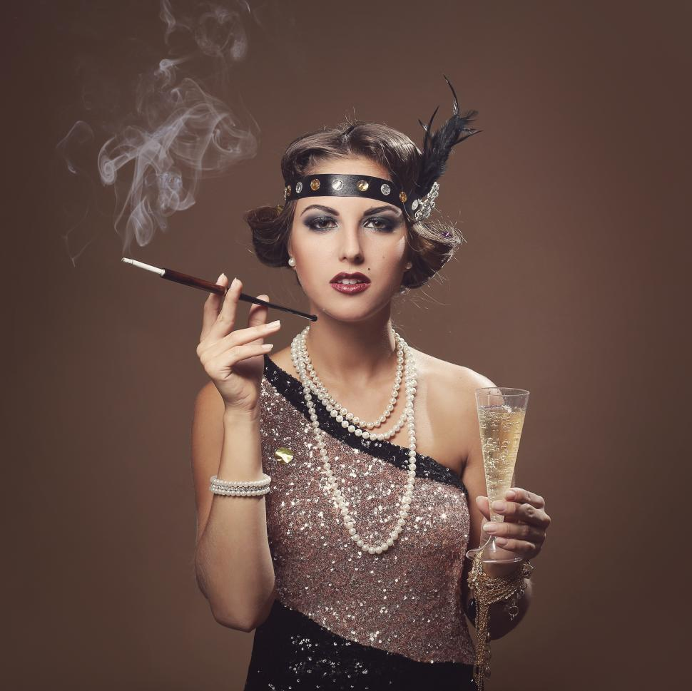 Download Free Stock Photo of Beautiful girl smoking, with glass of champagne