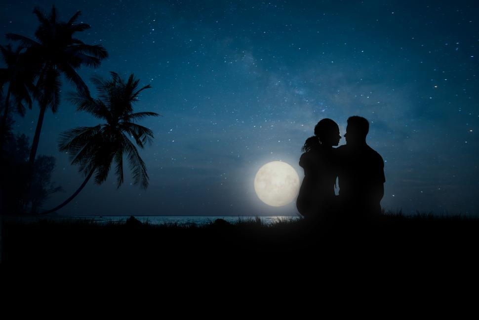 Download Free Stock Photo of Lovers at Night on the Beach - Romantic Couple Watching the Nigh