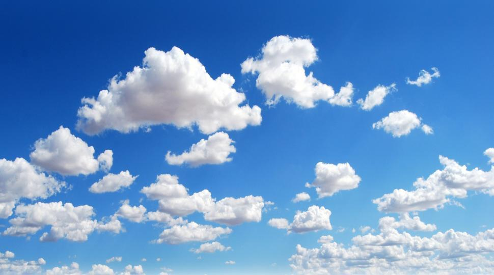 Download Free Stock Photo of Perfect Blue Sky Background - With Fluffy Clouds