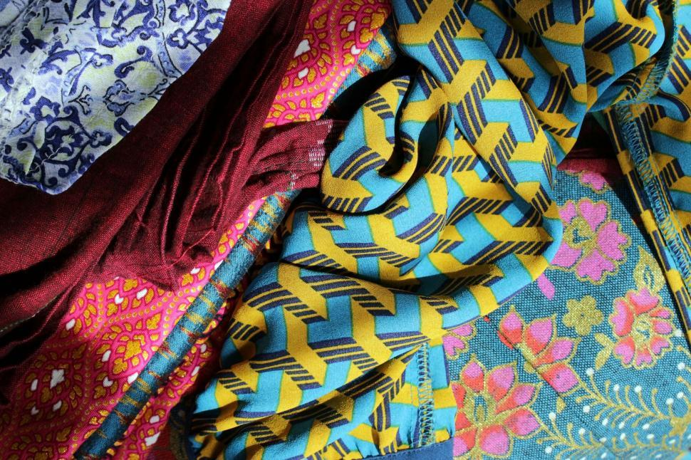 Download Free Stock Photo of Bright Fabrics Background