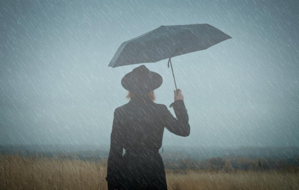 Download Free Stock Photo of Woman Walking Alone in the Rain - Loneliness Concept