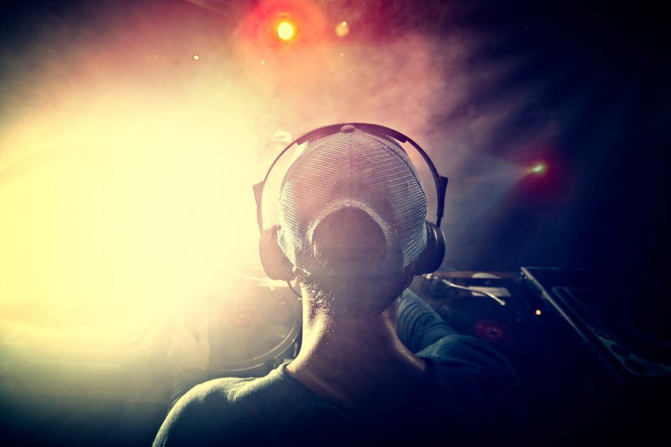 Download Free Stock Photo of DJ Mixing Music at a Club - Hazy Looks