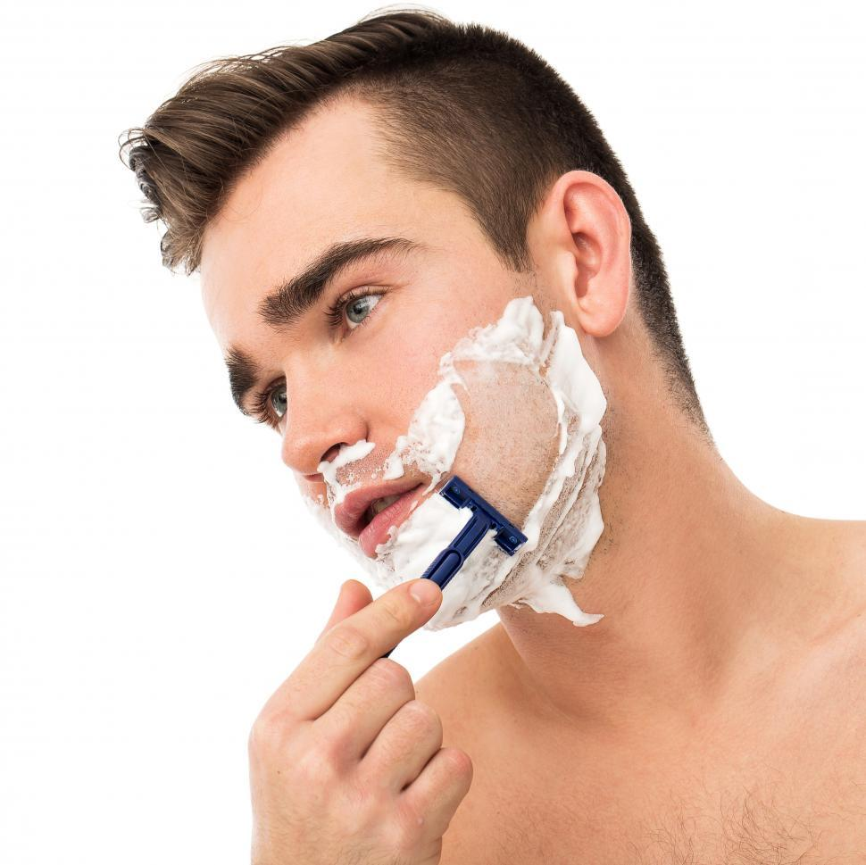 Download Free Stock Photo of Face care - shaving with disposable razor