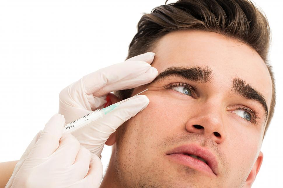 Download Free Stock Photo of Cosmetic surgery. Man receiving injections