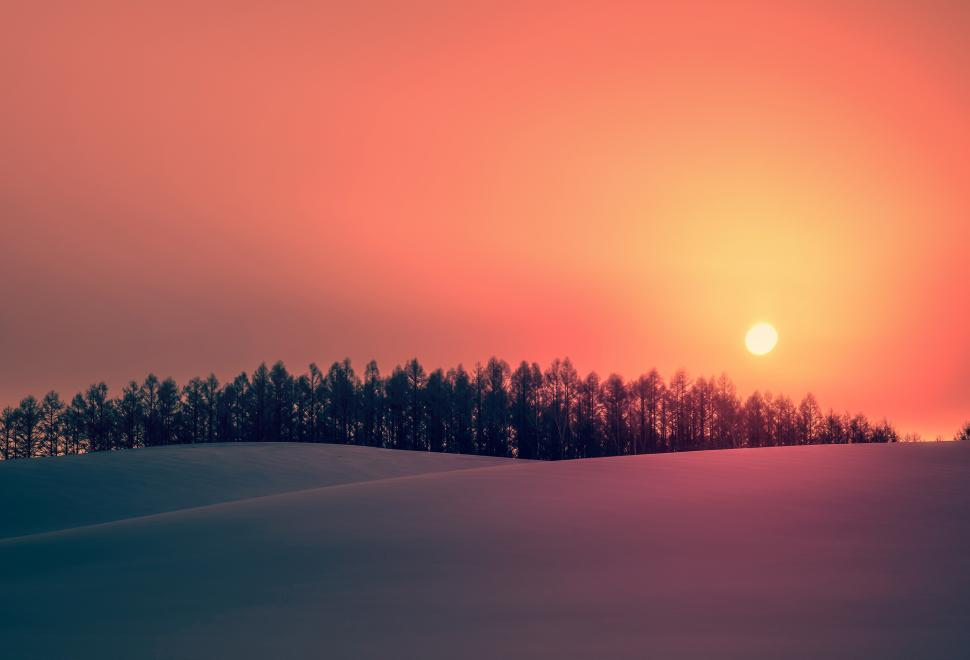 Download Free Stock Photo of Sun Rising over Snowy Landscape