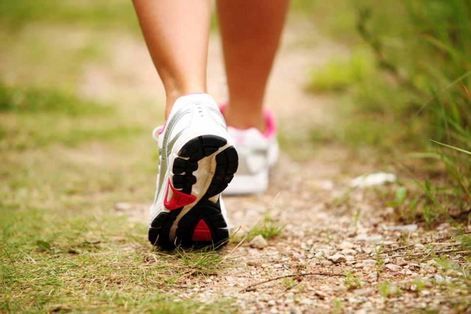 Download Free Stock Photo of Feet of a woman jogging on a trail