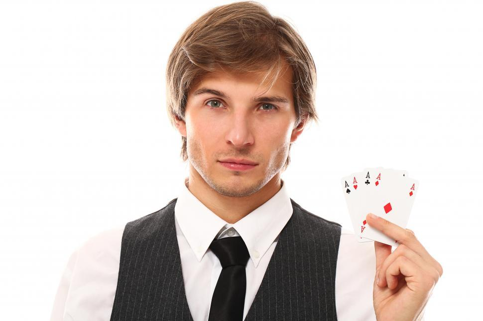 Download Free Stock Photo of Man with four aces in his hand