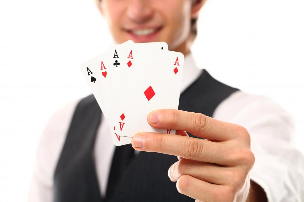 Download Free Stock Photo of Four aces, shown to the camera